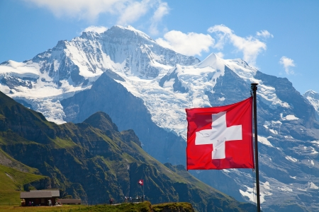 jungfraujoch: Swiss flag on the top of Mannlichen (Jungfrau region, Bern, Switzerland) Stock Photo