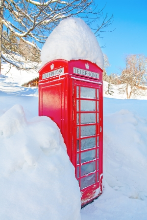 Famous red telephone booth covered by snow photo