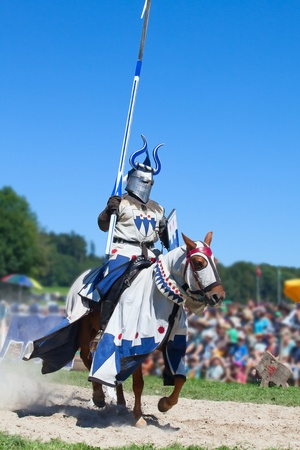knight horse: Knight on the horse taking part in tournament reconstruction Editorial