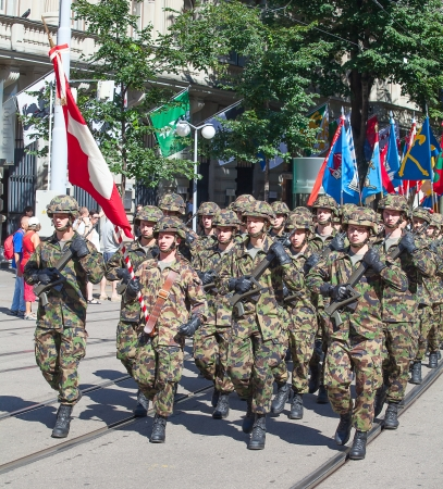 ZURICH - AUGUST 1: Infantry division of the Swiss army participating in the Swiss National Day parade on August 1, 2009 in Zurich, Switzerland. Stock Photo - 15131961