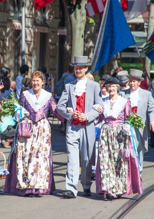 ZURICH - AUGUST 1: Citizens of Zurich in traditional costumes of XIXth century participating in the Swiss National Day parade on August 1, 2009 in Zurich, Switzerland. Stock Photo - 15131953
