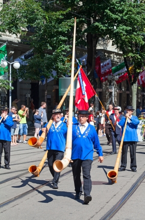 ZURICH - AUGUST 1: Representatives of canton Glarus with traditional alphorns participating in the Swiss National Day parade on August 1, 2009 in Zurich, Switzerland. Stock Photo - 15669514