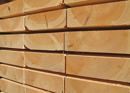 studs: Stack of new wooden studs at the lumber yard