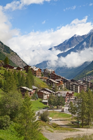 traditional climbing: Famous swiss city Zermatt in the valley near the swiss-italian border center of alpine sports Stock Photo