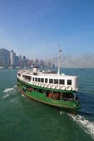 HONG KONG - DECEMBER 3: Ferry Meridian star leaving Kowloon pier on December 3, 2010 in Hong Kong, China. Hong Kong ferry is in operation for more than 120 years and it is one main tourist attractions of the city.