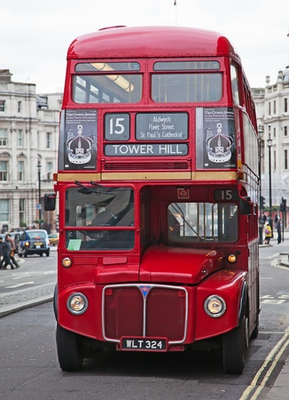 LONDON - FEBRUARY 13: Red Double Decker Bus on the Trafalgar square in London on Febuary 13, 2010 in London, UK. These dobledecker bus is one of the most iconic symbol of London. Editorial