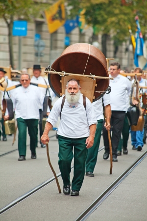 ZURICH - AUGUST 1: Swiss National Day parade on August 1, 2011 in Zurich, Switzerland. Representative of canton Appenzeller in a historical costume with cheese pan Stock Photo - 15986152