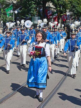 ZURICH - AUGUST 1: Zurich city orchestra in national costumes openning the Swiss National Day parade on August 1, 2012 in Zurich, Switzerland. Stock Photo - 15986155
