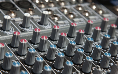 Mixer desk with various controls photo