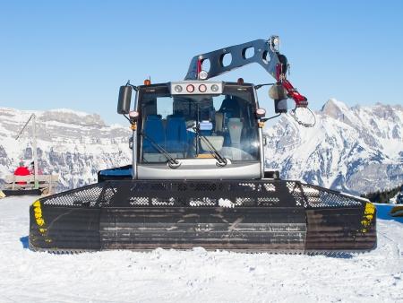 snowcat: Snow groomer in the swiss alps