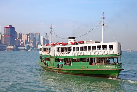 HONG KONG - DECEMBER 3: Ferry Solar star leaving Kowloon pier on December 3, 2010 in Hong Kong, China. Ferry is in operation in Victoria harbor for more than 120 years and is one of tourist attractions.