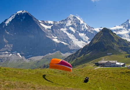 Paragliding in swiss alps Jungfrau region, Switzerland Stock Photo - 17021865