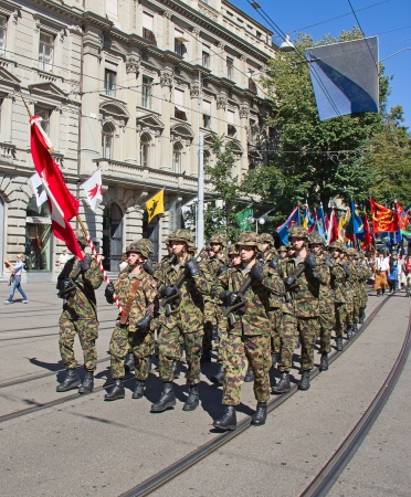 ZURICH - AUGUST 1: Infantry division of swiss army marching on the Swiss National Day parade on August 1, 2009 in Zurich, Switzerland. Stock Photo - 17003298