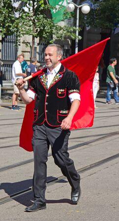 st gallen: ZURICH - AUGUST 1: Swiss National Day parade on August 1, 2009 in Zurich, Switzerland. Traditional swiss flag thrower in historical costume of canton St. Gallen