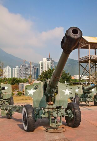 armaments: Old rusty chinese guns in a theme park near new buildings Editorial