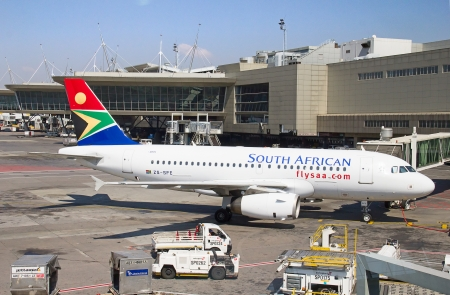 JOHANNESBURG - APRIL 18:Airbus A320 disembarking passengers after locall flight on April 18, 2012 in Johannesburg, South Africa. Johannesburg Tambo airport is the busiest airport in Africa Editorial