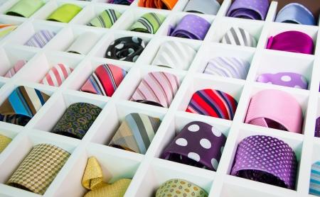 silk tie: Shelf full of fine silk neckties on a Chinese street market Stock Photo