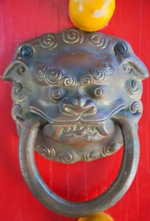 Traditional chinese lion head door knob photo