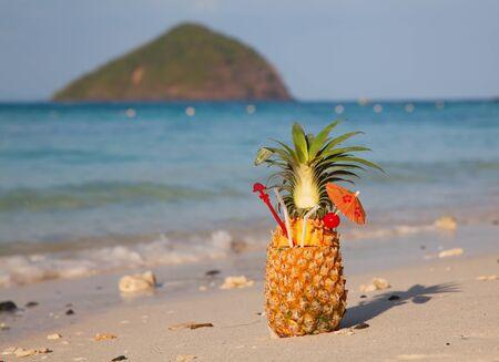 Fresh fruit cocktail on a tropical island beach Stock Photo - 17453988