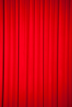 Brightly lit red curtains for background photo