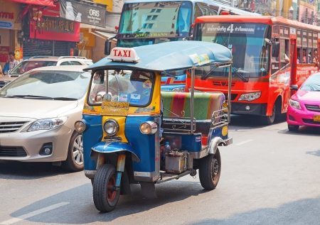 mototaxi: BANGKOK - FEBRUARY 20: Tuk-tuk moto taxi on the street in the Chinatown area on February 20, 2012 in Bangkok. Famous bangkok moto-taxi called tuk-tuk is a landmark of the city and popular transport.
