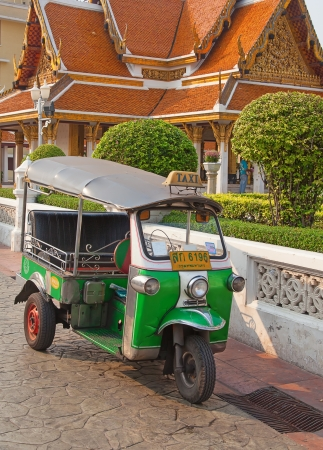 mototaxi: BANGKOK - FEBRUARY 20: Tuk-tuk moto taxi on the street near Wat Saket temple on February 20, 2012 in Bangkok. Famous bangkok moto-taxi called tuk-tuk is a landmark of the city and popular transport.