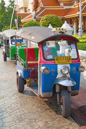 mototaxi: BANGKOK - FEBRUARY 20: Tuk-tuk moto taxi on the street near Wat Saket temple on February 20, 2012 in Bangkok. Famous bangkok moto-taxi called tuk-tuk is a landmark of the city and popular transport.