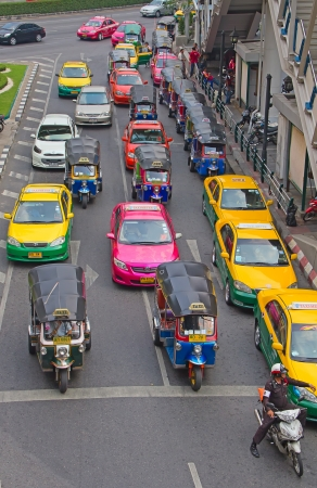 BANGKOK - FEBRUARY 20: Tuk-tuk moto taxi on the street near Central station on February 20, 2012 in Bangkok. Famous bangkok moto-taxi called tuk-tuk is a landmark of the city and popular transport.