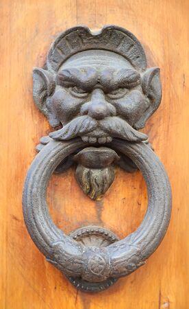 Vintage brass door knob on the wooden background Stock Photo - 18940775