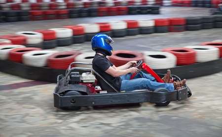 carting: Indoor karting race (kart against safety barriers) Stock Photo