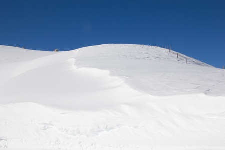 snowbank: Snow drifts in the swiss alps