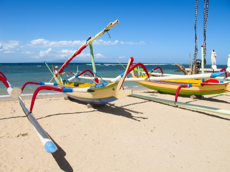 Traditional balinese dragonfly boat on the beach photo