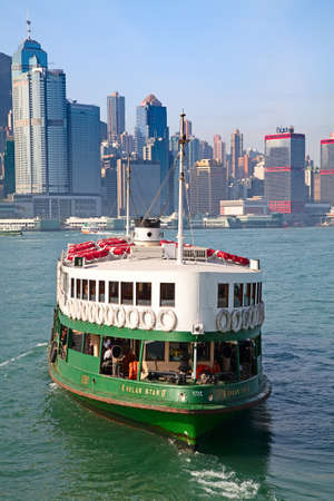 HONG KONG - DECEMBER 3: Ferry Solar star leaving Kowloon pier on December 3, 2010 in Hong Kong, China. Hong Kong ferry is in operation in Victoria harbor for more than 120 years.
