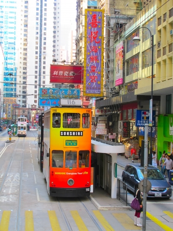 HONG KONG - DECEMBER 05: Unidentified people using city tram in Hong Kong on December 05, 2010. Tram in Hong Kong is the only tram system in the world run with double deckers and one of the main tourist attractions.