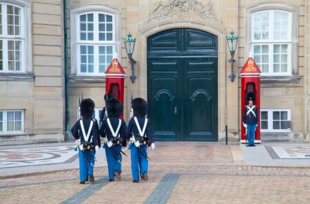 military watch: COPENHAGEN, DENMARK - AUGUST 25: unidentified soldiers of the Royal Guard in Amalienborg Castle by changing the guards on August 25, 2010 in Copenhagen, Denmark Editorial