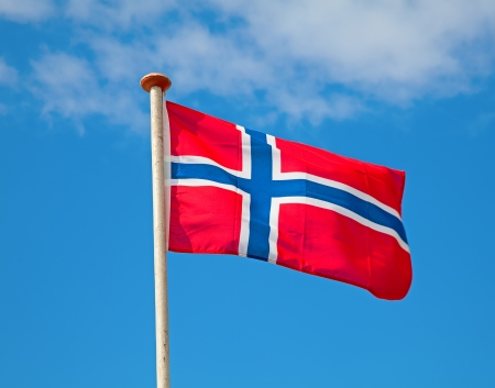 Flag of Norway in the blue sky