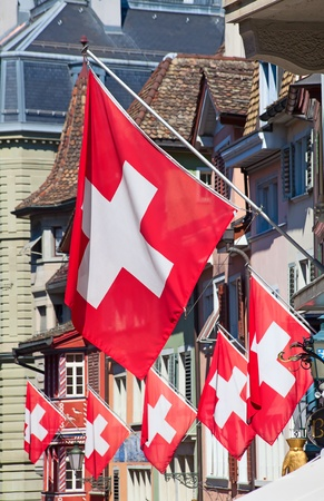 ancient pass: Ancient street Augustinergasse in Zurich decorated with swiss flags