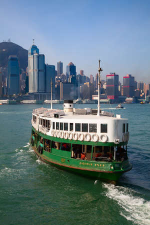 HONG KONG - DECEMBER 3: Ferry Meridian star leaving Kowloon pier on December 3, 2010 in Hong Kong, China. Hong Kong ferry is in operation in Victoria harbor for more than 120 years.