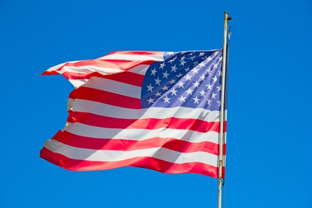 Flag of the United States against blue sky photo