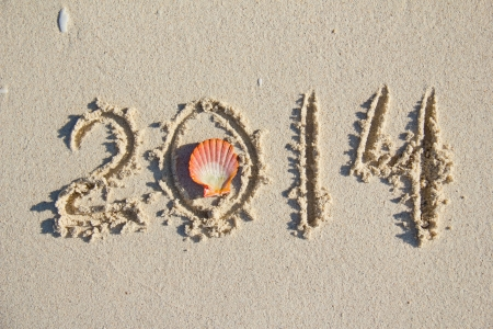 Drawing '2014' on the sandy beach photo