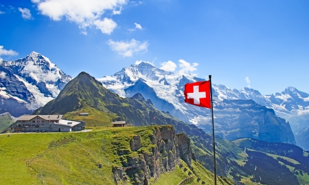 Swiss flag on the top of Mannlichen (Jungfrau region, Bern, Switzerland) Stock Photo