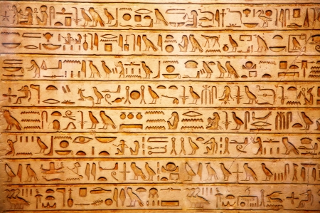 ancient civilization: old egypt hieroglyphs carved on the stone
