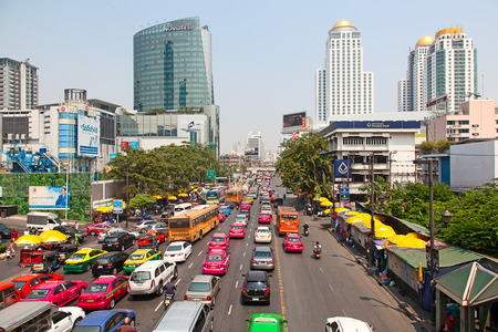 despite: BANGKOK - MARCH 3: Daily traffic jam in the afternoon on March 3, 2012 in Bangkok, Thailand. Traffic jams remains constant problem in Bangkok despite rapid development of public transportation system. Editorial
