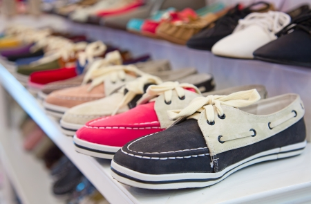 variety of the colorful leather shoes in the shop  photo