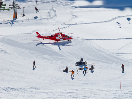skiing accident: FLUMSERBERG - FEBRUARY 21: The rescue helicopter evacuates skiier after heavy accident, Flumserberg, Switzerland on February 21, 2010. Skiing safety becoming an issue on crowded slopes.