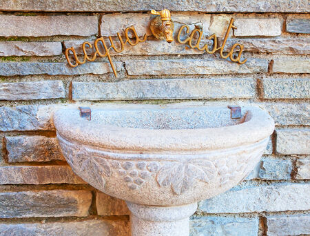 Ancient fountain in a small italian town photo