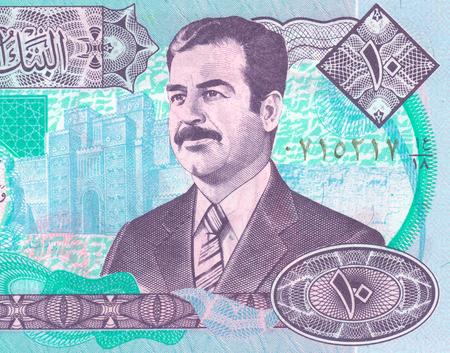 iraqi: Fragment of the Iraqi banknote with Saddam Stock Photo