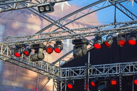 Fragment of stage illumination on the free air rock concert