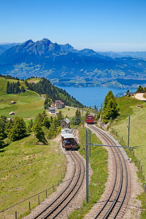 Swiss alpine cog railway train climbing up to the mount Rigi photo