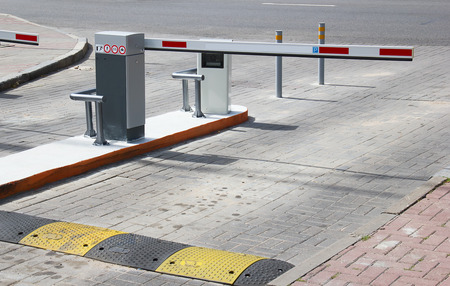 cars parking: Barrier on the car parking Stock Photo